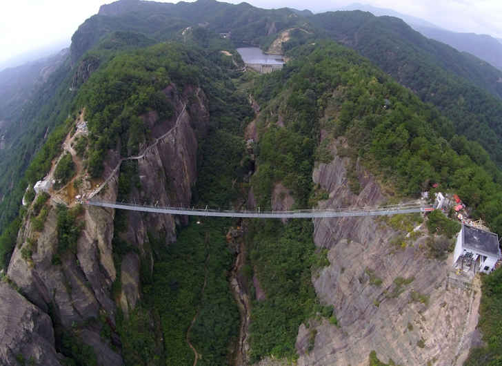 "China Opens Glass Bridge 600 Feet Suspended Above Ground Called ""Brave Man's Bridge"" – Would You Walk Across?"