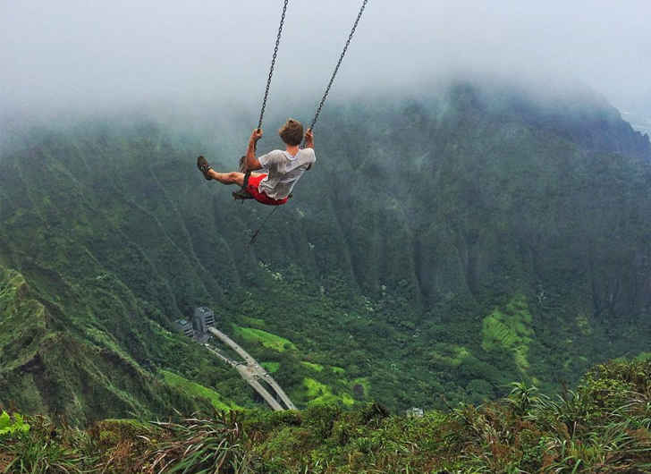 Adrenalin Junkies Flock to Forbidden Hike In Hawaii to Ride Swing Among Mountaintops
